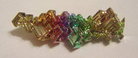 Crystal of ultrapure bismuth. Photo credit: Intangir (public domain)