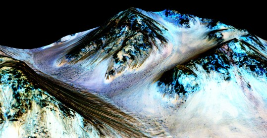 Water flowing on Mars. Site: Hale crater, Mars. Dark brown: a hundred meters long & few meters wide streaks of hydrated salts. Credits: NASA/JPL/University of Arizona