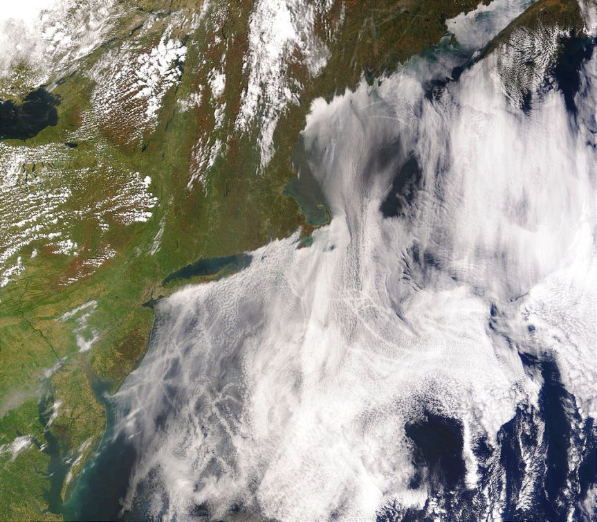 Satellite image of clouds created by the exhaust of ship smokestacks (2005). Credit: NASA. License: PD.